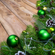 Christmas garland with green baubles on the rustic wooden backgr - PhotoDune Item for Sale