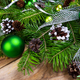 Christmas holiday greeting background with green ornaments - PhotoDune Item for Sale