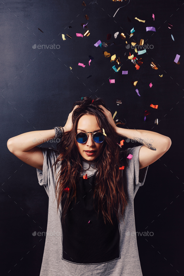 Adorable girl having fun with confetti - Stock Photo - Images