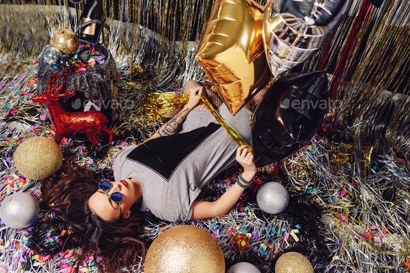 Glamorous party girl wearing sunglasses - Stock Photo - Images
