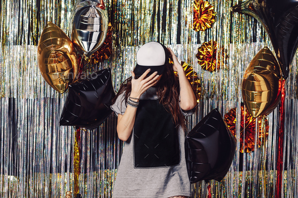 Party girl with copyspace on t-shirt and cap - Stock Photo - Images
