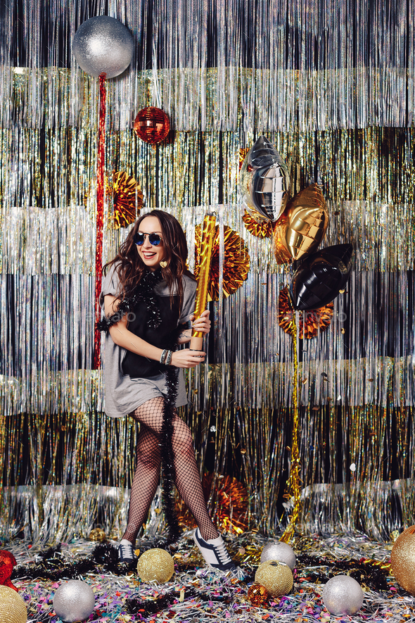 Portrait girl enjoying party and confetti - Stock Photo - Images