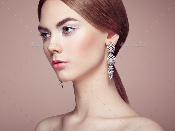 Fashion portrait of young beautiful woman with jewelry - Stock Photo - Images