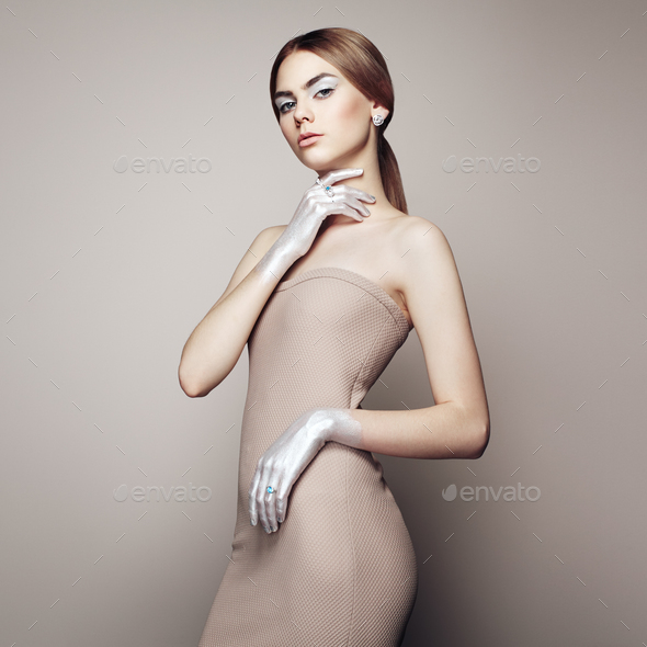 Fashion portrait of elegant woman in dress - Stock Photo - Images
