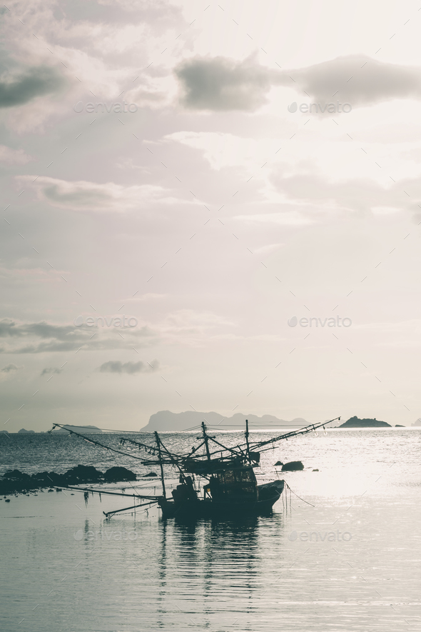 Fisherman boat with sunset scene in koh phangan. Horizontal imag - Stock Photo - Images