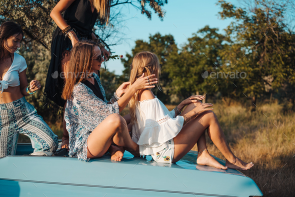 Girls plaiting pigtails - Stock Photo - Images