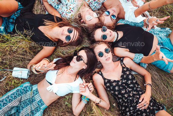 Six girls lie on the grass - Stock Photo - Images