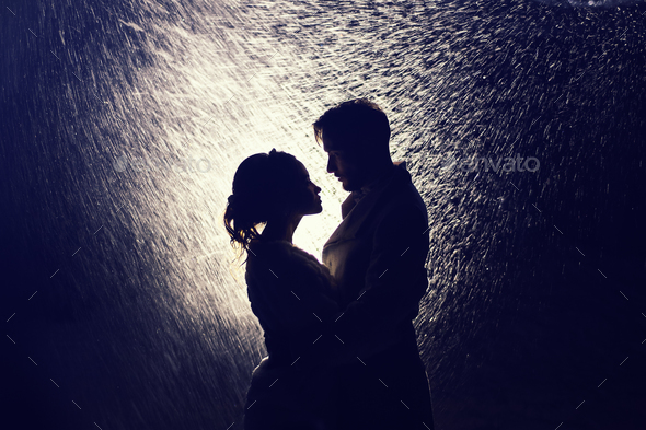 Happy couple of lovers in the backlight - Stock Photo - Images