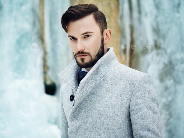 Outdoor portrait of handsome man in gray coat - Stock Photo - Images