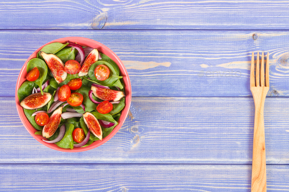 Fresh prepared fruit and vegetable salad with wooden fork - Stock Photo - Images