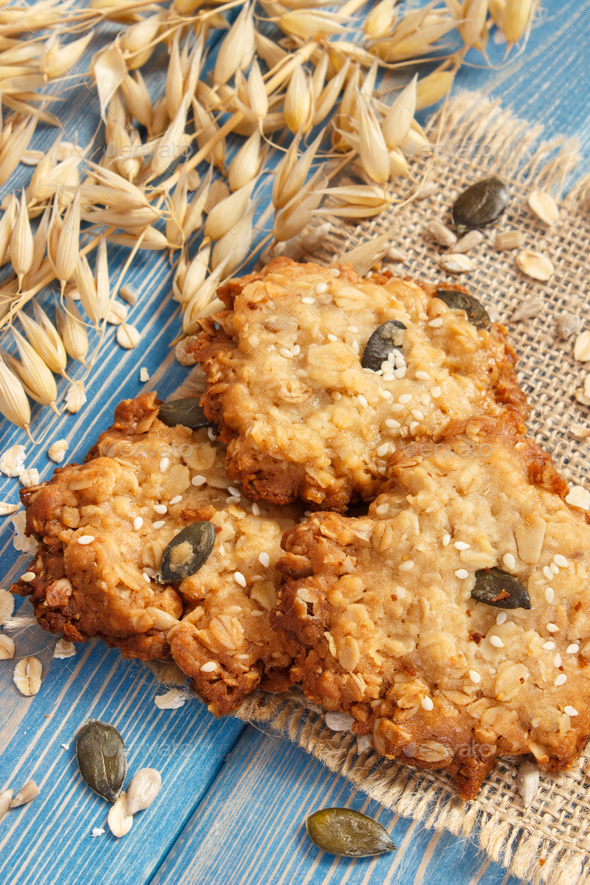 Oatmeal cookies with ingredients for baking, healthy dessert concept - Stock Photo - Images