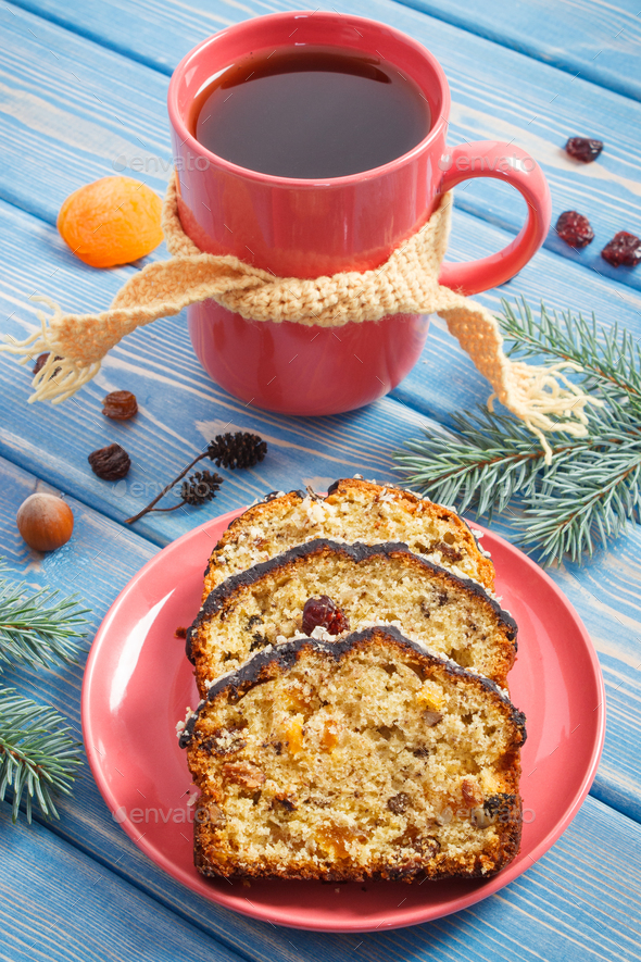 Cup of hot tea, fresh baked fruitcake for Christmas time and spruce branches - Stock Photo - Images