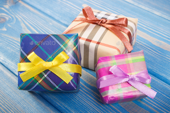 Wrapped colorful gifts with ribbons for Christmas festive time or other celebration - Stock Photo - Images