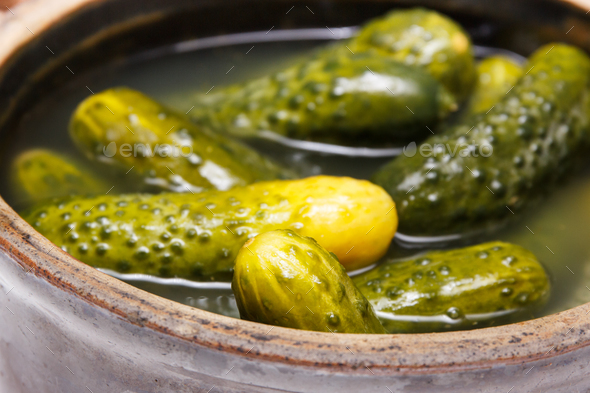 Fresh homemade pickled cucumbers in clay pot - Stock Photo - Images