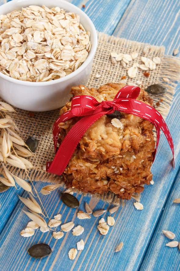 Oatmeal cookies with ingredients and ears of oat, healthy dessert concept - Stock Photo - Images