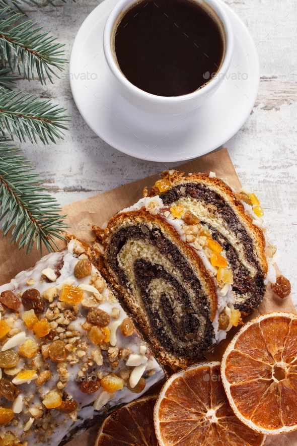 Poppy seeds cake, cup of coffee and spruce branches, dessert for Christmas time - Stock Photo - Images