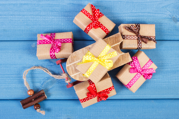 Wooden sled and wrapped gifts with ribbons for Christmas or other celebration - Stock Photo - Images