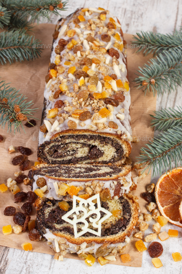 Homemade poppy seeds cake and spruce branches, dessert for festive Christmas time - Stock Photo - Images