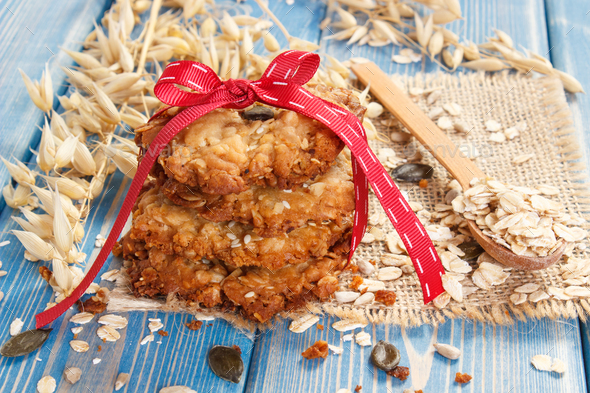 Oatmeal cookies with ingredients and ears of oat - Stock Photo - Images
