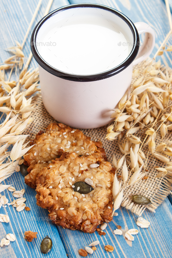 Oatmeal cookies, ingredients for baking and ears of oat, healthy dessert - Stock Photo - Images