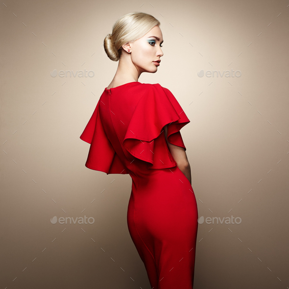 Fashion portrait of elegant woman in red dress - Stock Photo - Images