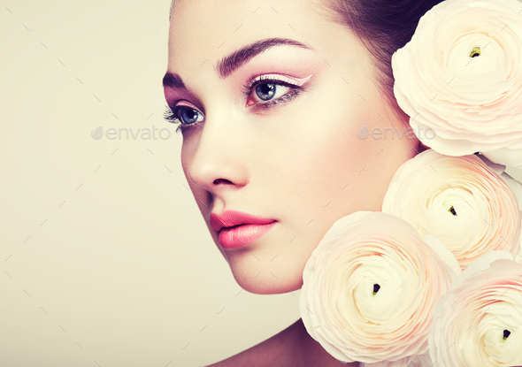 Portrait of beautiful young woman with flowers - Stock Photo - Images