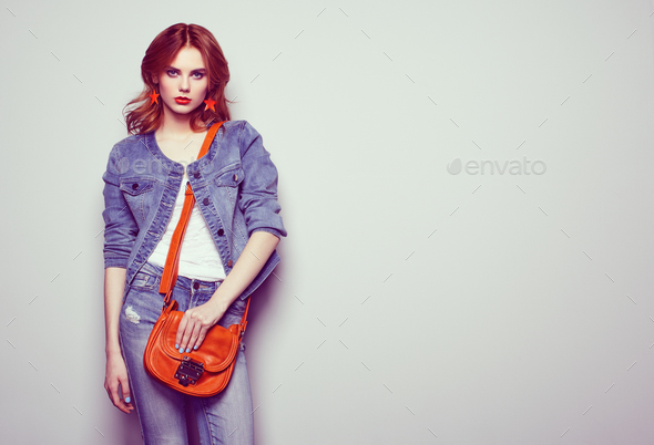 Fashion portrait of beautiful young woman with handbag - Stock Photo - Images