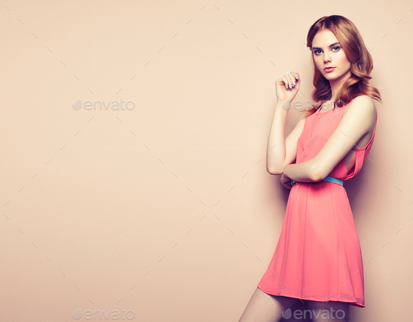 Fashion portrait of beautiful young woman in a summer dress - Stock Photo - Images
