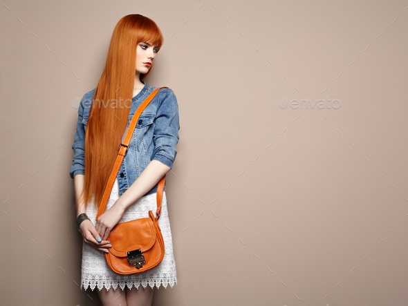 Fashion portrait of beautiful young woman with red hair - Stock Photo - Images