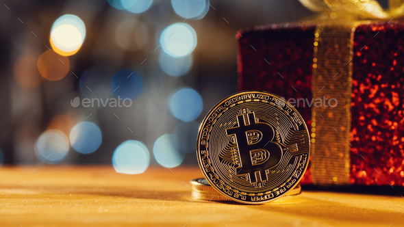 Bitcoin BTC cryptocurrency and Christmas gift box - Stock Photo - Images