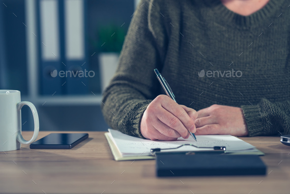 Female freelancer doing paperwork - Stock Photo - Images