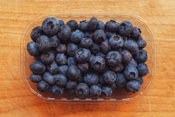 Blueberries myrtilles in plastic container box - Stock Photo - Images