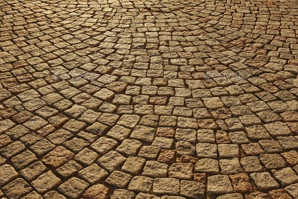 Street paving stone in warm tone. Antique urban sidewalk. Horizontal - Stock Photo - Images