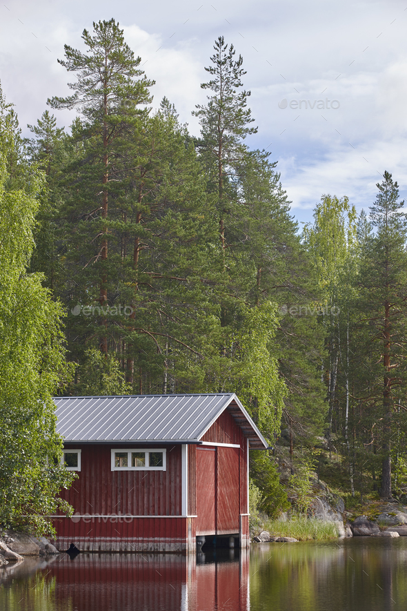 Finland landscape forest lake and red wooden cabin. Finnish summer - Stock Photo - Images