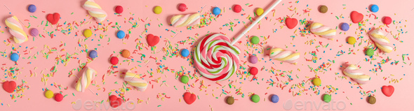 Colorful candies on pink background, top view - Stock Photo - Images