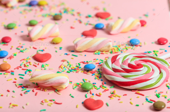 Colorful candies on pink background - Stock Photo - Images