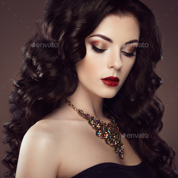 Brunette woman with curly hairstyle - Stock Photo - Images
