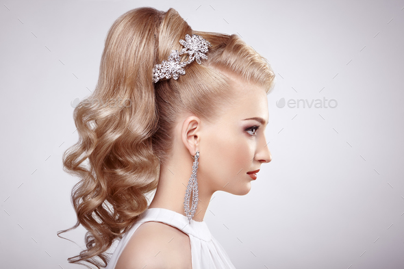 Fashion portrait of young beautiful woman with elegant hairstyle - Stock Photo - Images