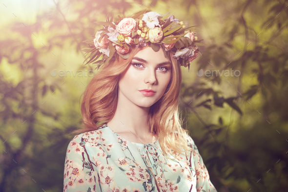 Beautiful blonde woman with flower wreath on her head - Stock Photo - Images