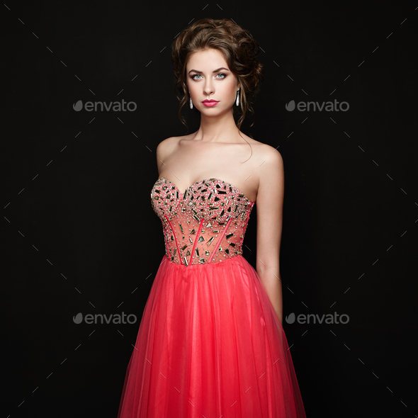 Fashion portrait of beautiful woman in elegant dress - Stock Photo - Images