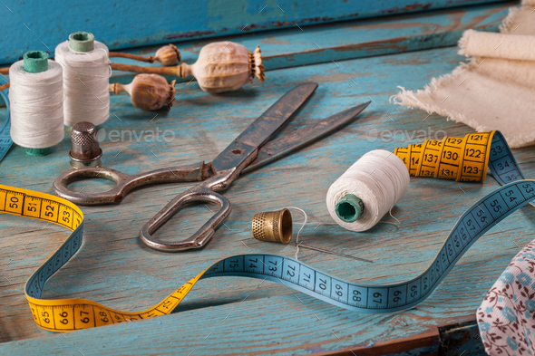 Retro sewing accessories on blue wooden background - Stock Photo - Images