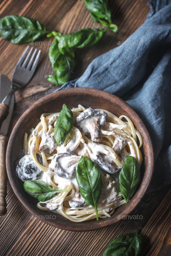Portion of creamy mushroom linguine - Stock Photo - Images
