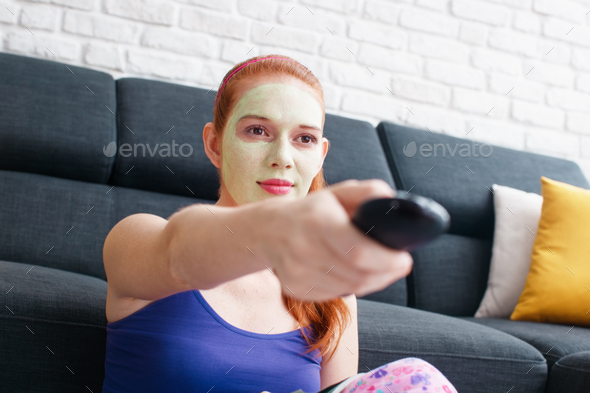 Girl With Beauty Mask Watching Television At Home - Stock Photo - Images