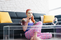 Girl With Beauty Mask Reading And Watching Television At Home - PhotoDune Item for Sale
