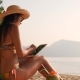 Young Tourist Girl Using Mobile Tablet Sunbathing on Tropical Beach - VideoHive Item for Sale