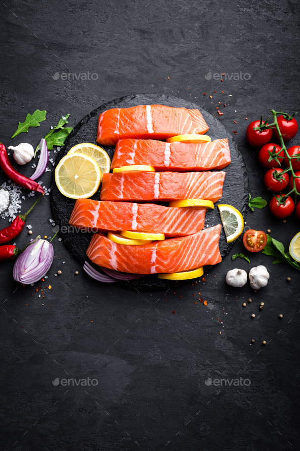 Fresh raw salmon red fish fillet on black background. Top view - Stock Photo - Images
