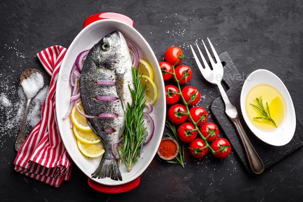 Fresh raw dorado fish on black background, top view - Stock Photo - Images