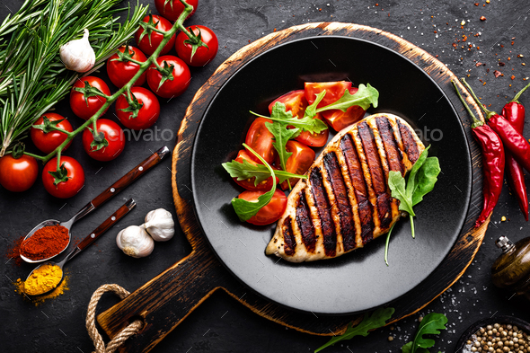 Grilled chicken fillet on black background. Top view - Stock Photo - Images