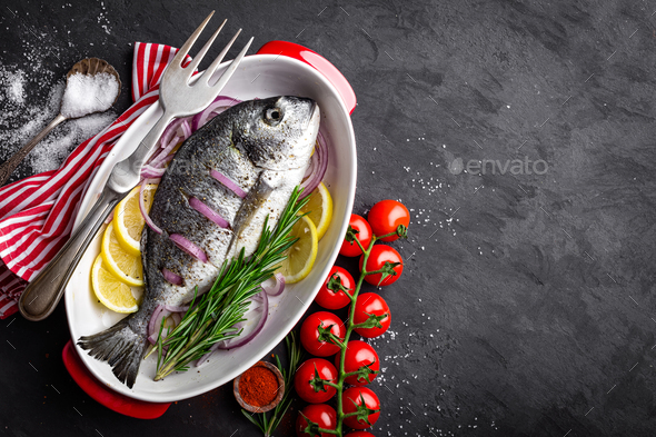 Fresh raw dorado fish on black background, top view - Stock Photo - Images