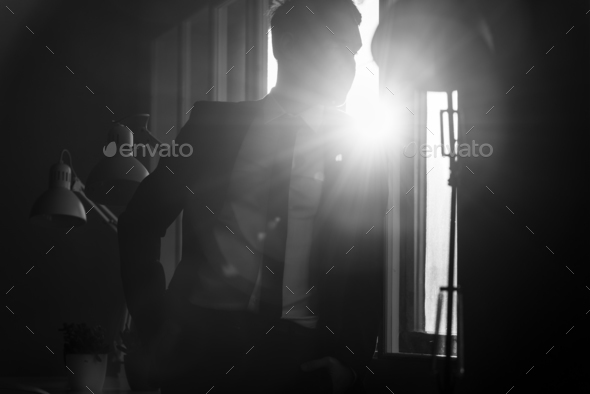 Businessman in a shadowy office - Stock Photo - Images
